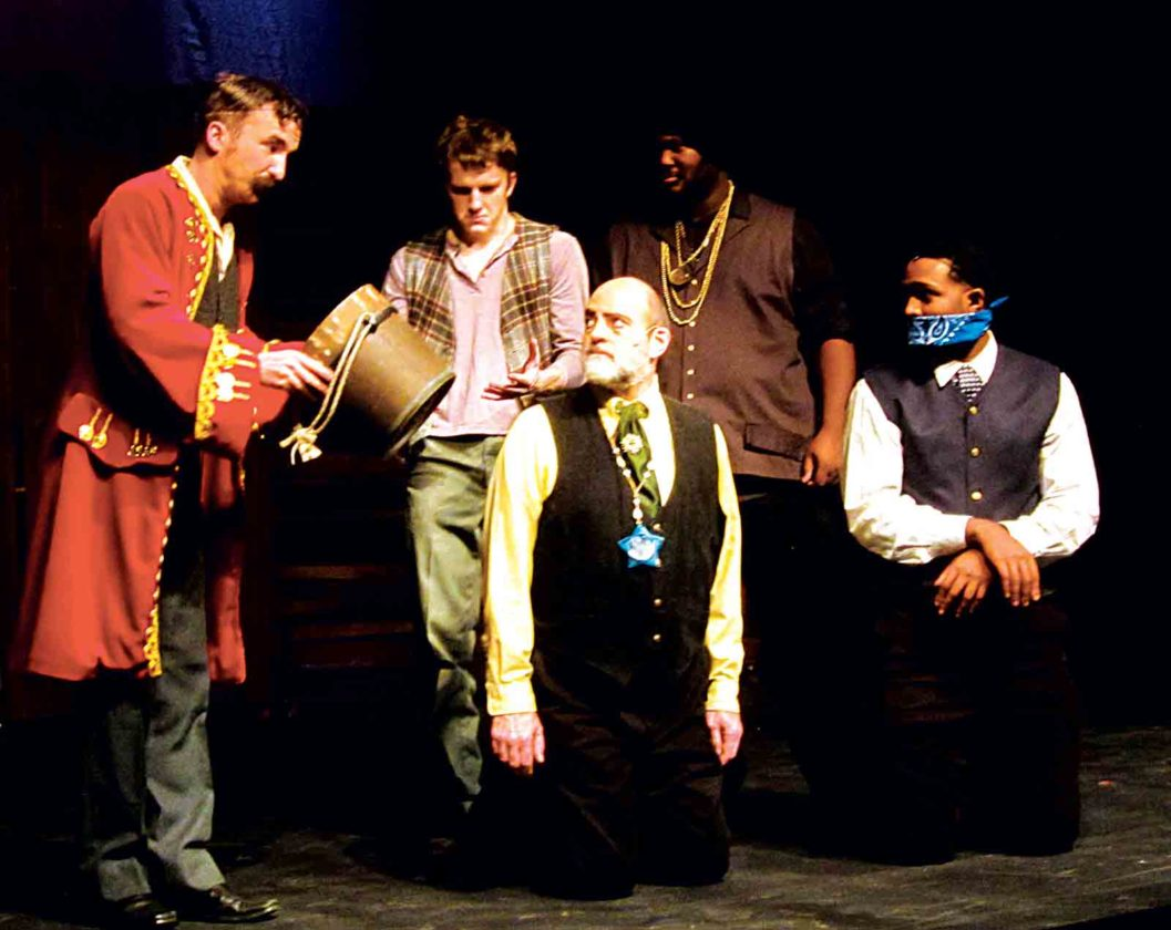 """Photo by Wayne Towner Marty Jellison, left, as Black Stache, tries to get a key from Lord Leonard Aster, center, played by Bill Knotts in the Actors Guild of Parkersburg production of """"Peter and the Starcatcher."""""""