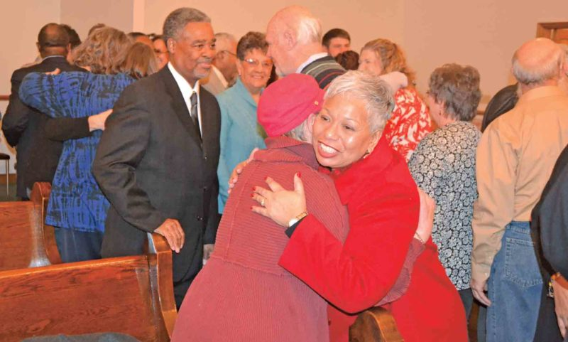 "File Photo During the singing of the song ""Jesus In Me,"" those in attendance at a special service commemorating the legacy of the Dr. Rev. Martin Luther King Jr. got up and greeted each other with hugs, handshakes and greetings last year at Zion Baptist Church in Parkersburg."