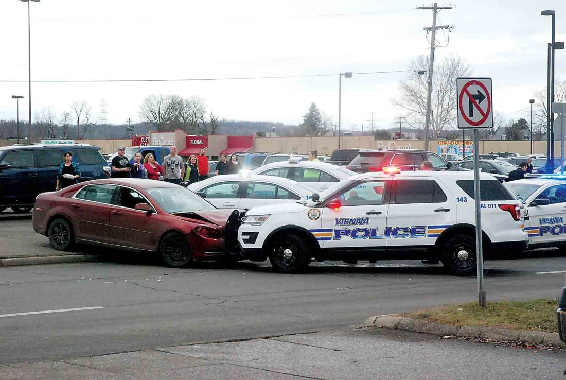 Photo by Evan Bevins A 2011 Chevrolet Malibu, left, reported stolen on Jan. 7, was stopped by Vienna Police on Ohio Avenue in Parkersburg Thursday afternoon after a pursuit that began at Grand Central Mall.