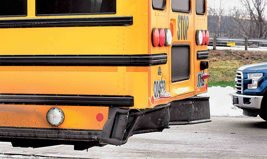 Photo by Jeff Baughan A side view shows the damage to the rear section of the Warren Local Schools bus after it was hit Thursday morning.