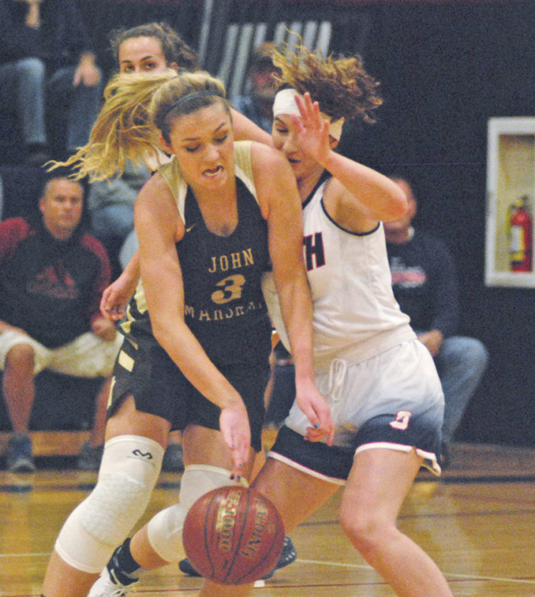 Parkersburg South's Kenzie Johnson plays tight defense against John Marshall's Avery Derrow in a game earlier this year inside the Rod Oldham Athletic Center. The Patriots will play host to Boyd County from Kentucky at 1:30 p.m. Saturday. Photo by Jay W. Bennett.
