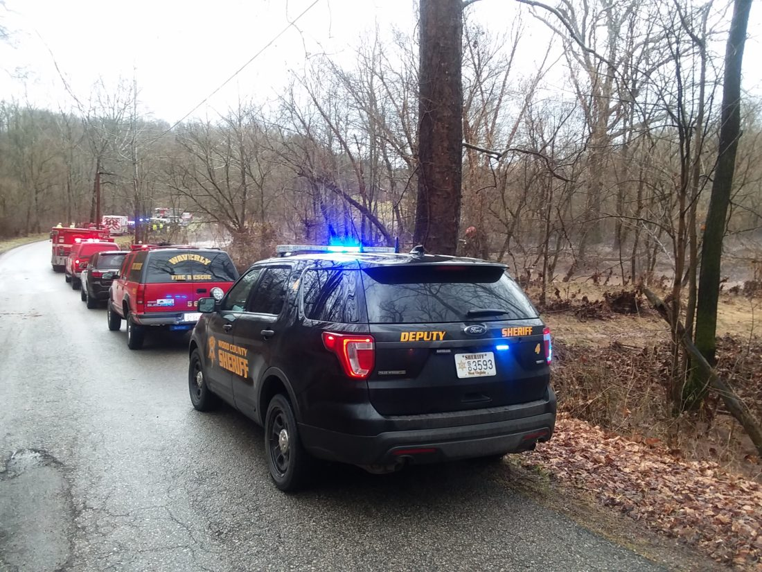 The scene today on Laurel Creek Road where the body of a woman was found in a vehicle submerged in high water from Laurel Creek. The search is on for a second person who may have been in the vehicle, Wood County Sheriff Steve Stephens said.