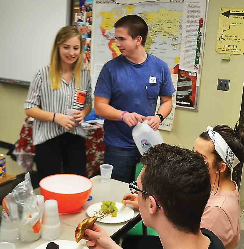 Photo by MichaelKelly American Foreign Students exchange high school students Melanie Vogel from Austria and Bronislav Theuer from the Czech Republic talk to Marietta High School students while getting snacks after a presentation Friday.