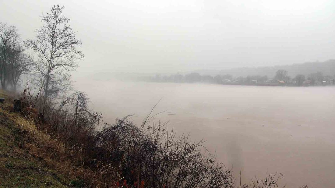 Photo by Jeffrey Saulton The fog on the Ohio River in Vienna gave an eerie appearance to Spencer's Landing on Friday.
