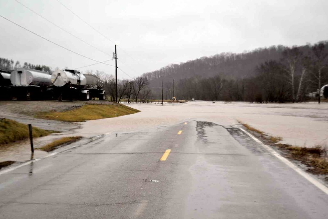 Photo by Michael Kelly Ohio 821 just south of Whipple was closed Friday afternoon as Duck Creek rose and covered the road with water.