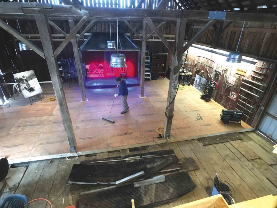 Photo by Janelle Patterson Rick Shriver sweeps the newly installed floor of his family barn as renovations to turn the hay barn into a destination winery and Amish goods shop take place Tuesday.