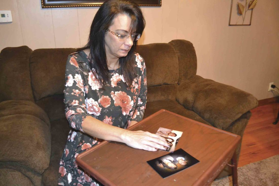 Photo by Michael Kelly Lenora Lada looks at pictures of her son, Trey Moats, on Monday, more than a month after he died from an overdose after a group of companions decided to take him to a private home rather than a hospital.