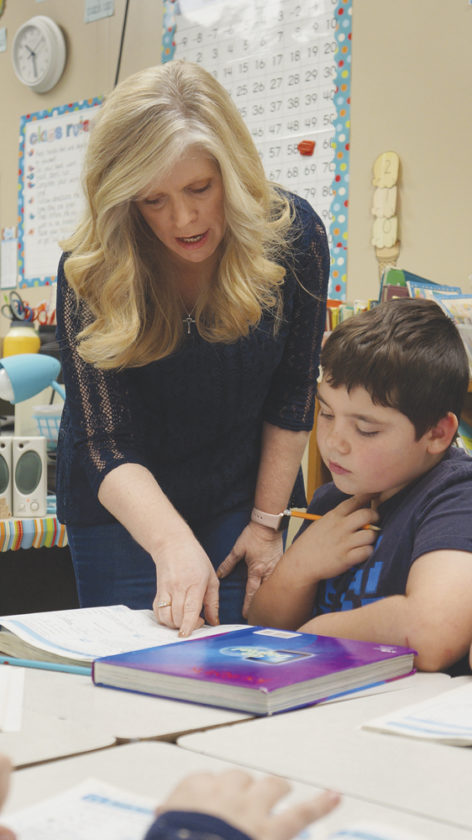 Photo by Michael Erb Blennerhassett  Elementary School teacher Lisa Smith works with third-grader Bryson  Buffington on Tuesday at the school.
