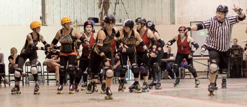 The Hades Ladies, the Mid-Ohio Valley's Roller Derby team, competes in a bout during league action. (Photo by Grath Photography & Design)