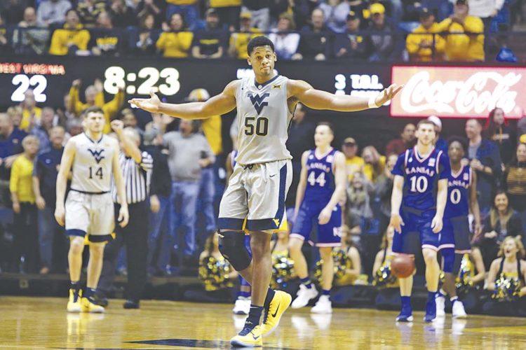 West Virginia forward Sagaba Konate (50) celebrates a West Virginia run during the first half of an NCAA college basketball game Monday against Kansas in Morgantown.