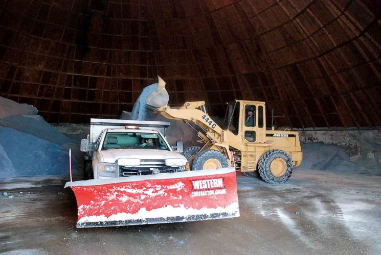 Photo by Evan Bevins City of Parkersburg medium equipment operator Roger Hanley gets his truck refilled with salt at the municipal salt dome off Camden Avenue Wednesday afternoon.