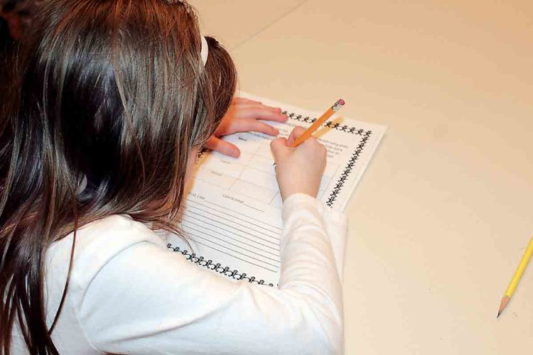 Illustration by Evan Bevins A Belpre Elementary School second-grader works on a calamity day assignment.