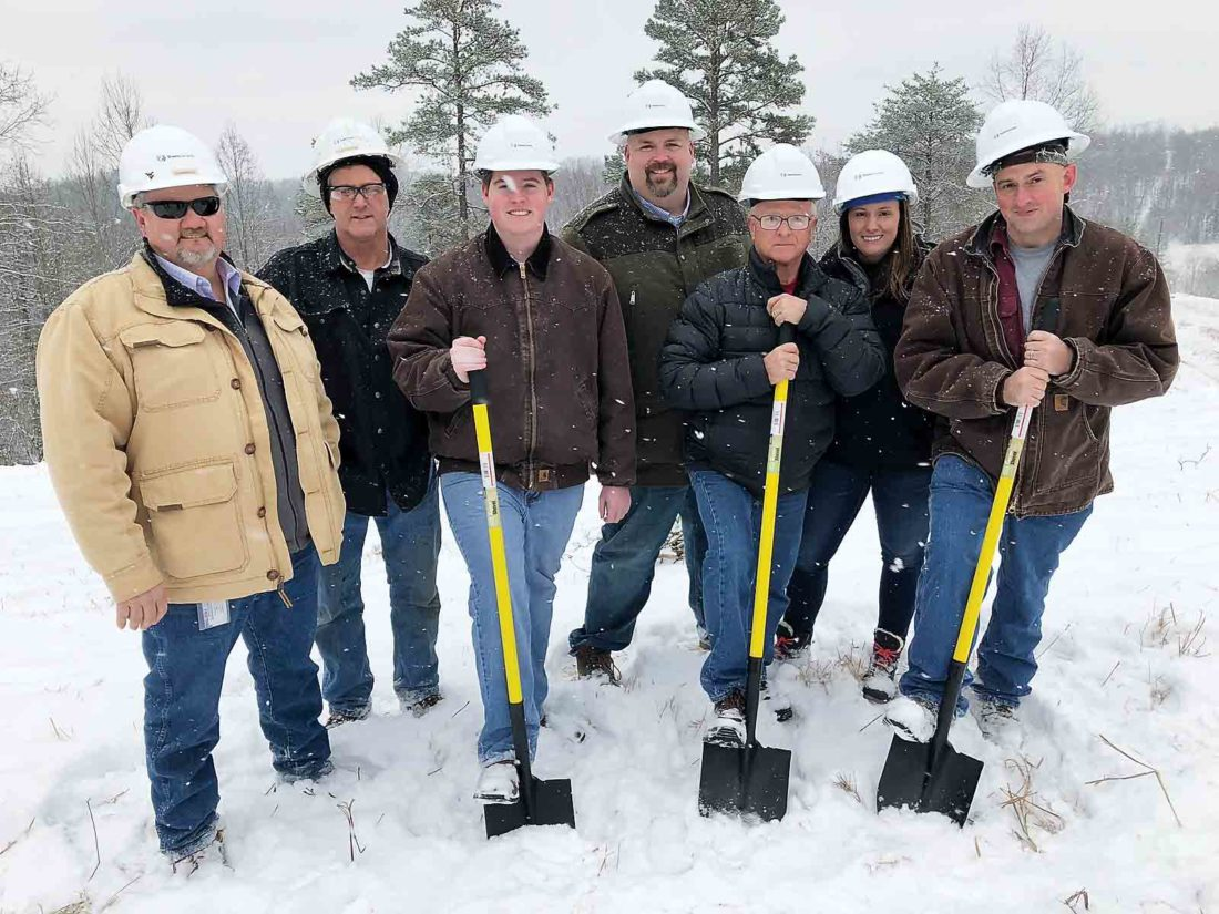"""Photo Provided Representatives from the Calhoun County Commission and TransCanada stand in the snow and cold for a groundbreaking ceremony Tuesday at the site of the White Oak Compressor Station in Calhoun County. The $94 million station is one of three compressor operations planned in the $2 billion, 165-mile Mountaineer XPress Pipeline. From left, Tim Chambers of TransCanada, Earl Vineyard of TransCanada, Commissioner Michael Hicks, Matthew Franklin of TransCanada, Commissioner Scottie """"Chip"""" Westfall II, Brittany Carns of TransCanada and Commission President Kevin Helmick."""