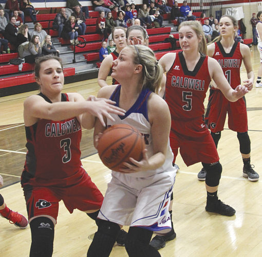 Fort Frye's Karlee Ross, right, makes a move with the ball as Caldwell's Lexie Weisend defends during a high school girls basketball game Thursday in Beverly. Photo by Tom Perry.