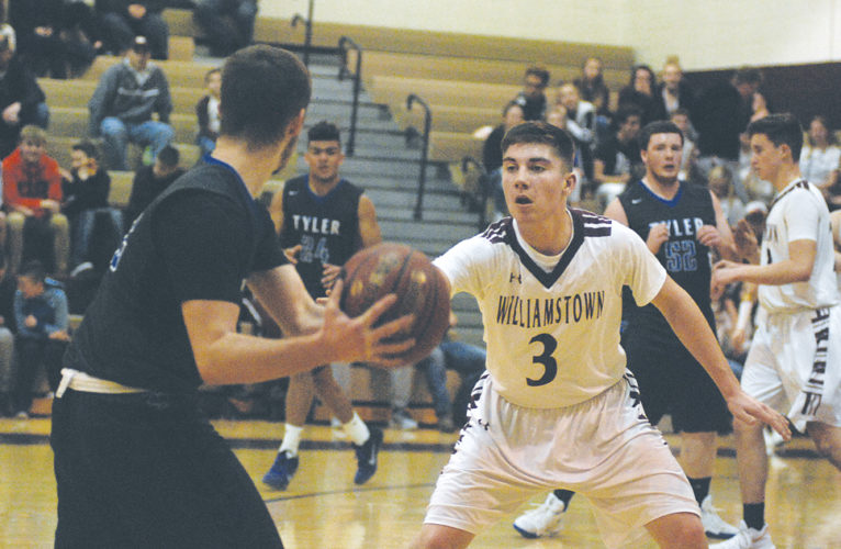 Williamstown's Trent Lynch applies pressure against Tyler Consolidated's Luke Daugherty during the Yellowjackets' 60-53 victory Thursday night versus the visiting Silver Knights. Photo by Jay W. Bennett.