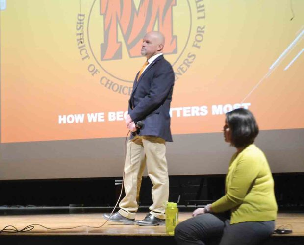 Photo by Michael Kelly Marietta City Schools Superintendent Will Hampton and curriculum director Jona Hall listen as community members ask questions and indicate their positions at a meeting Thursday night about the district's proposal to realign the elementary school system.