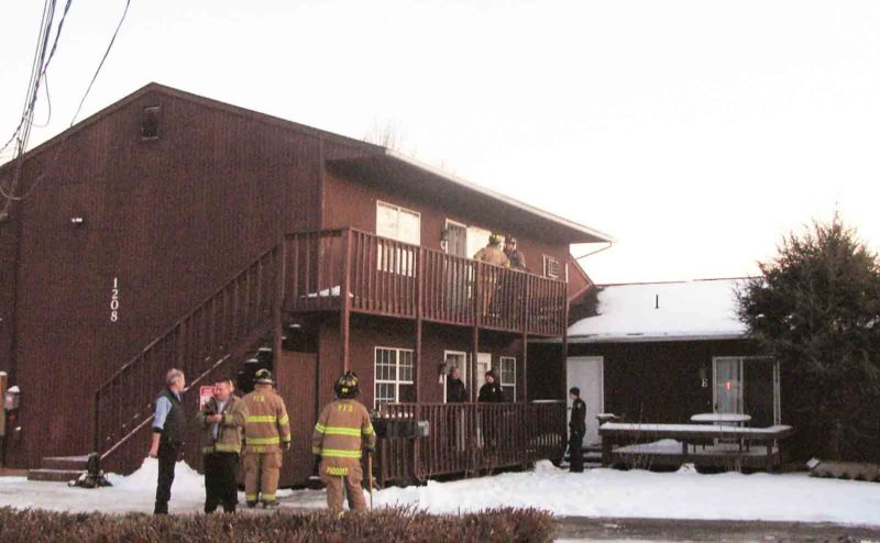 Photo by Jeffrey Saulton Firefighters from the Parkersburg Fire Department responded to a fire in this apartment building at 1208 Camden Ave. Friday evening.