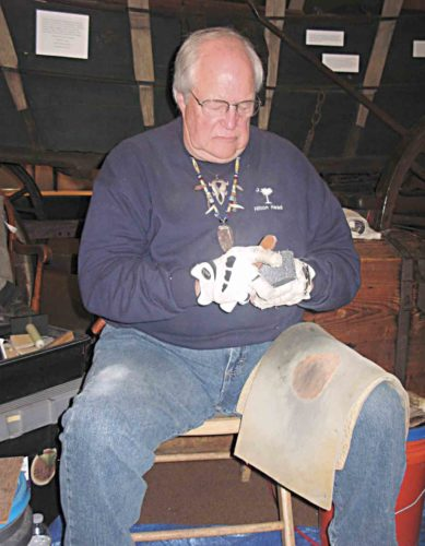 """Photo by Jeffrey Saulton Mike Dull, of North Canton, Ohio, was demonstrating flint knapping at the annual Campus Martius Museum """"Digging the Past — Archaeology Day."""""""