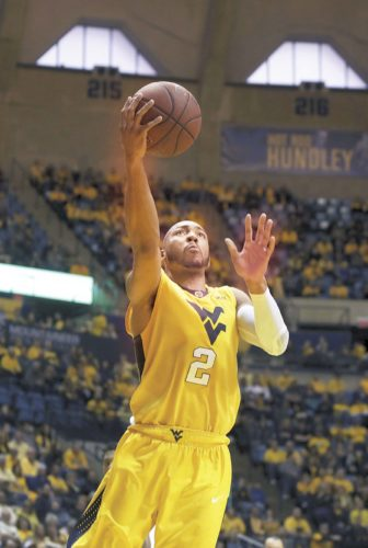 West Virginia guard Jevon Carter (2) drives to hoop during the second half of an NCAA college basketball game against Texas Saturday, Jan. 20, 2018, in Morgantown, W.Va. West Virginia defeated Texas 86-51. (AP Photo/Raymond Thompson)