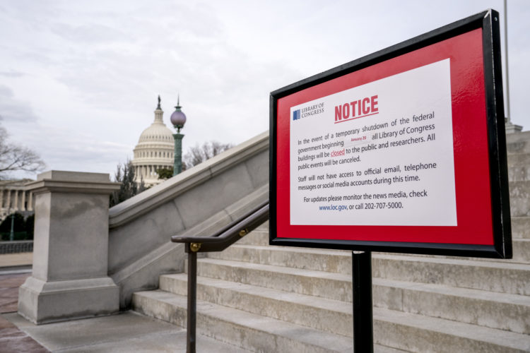 The dome of the Capitol Building is visible behind a closure sign that is posted outside of the Library of Congress in Washington, Monday, Jan. 22, 2018. The federal government shut down last Friday, halting all but the most essential operations. (AP Photo/Andrew Harnik)
