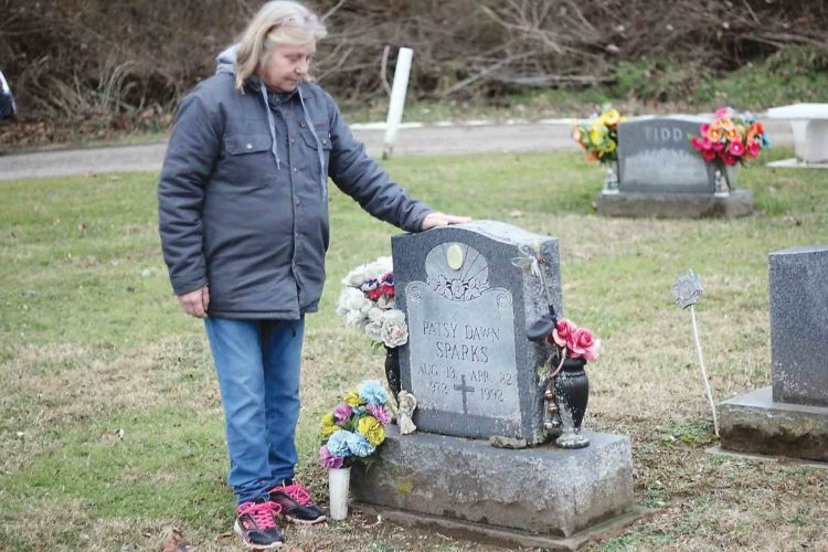 Helen Francis, 60, of Marietta, visits the grave of her daughter Patsy Sparks in Reno Tuesday, the day the Ohio Attorney General's Office announced Sparks' suspected killer had been indicted in Noble County. (Photo by Janelle Patterson)