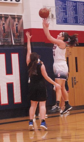 Photo by Steve Hemmelgarn Parkersburg South's Allie Taylor elevates for a shot during the Patriots' 72-59 victory over Teays Valley Christian. Taylor chipped in 19 points in the winning effort.