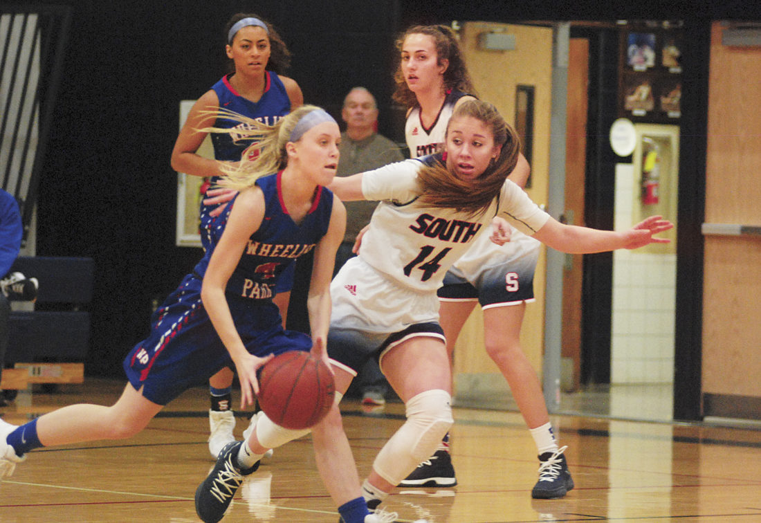 Parkersburg South's Devin Hefner guards Wheeling Park's Emily Pavlic, whilte South's Makenna Winans looks on during South's 75-67 loss to Park back on Dec. 9. Both Winans and Hefner are going to be key factors in tonight's game against the Big Reds. 