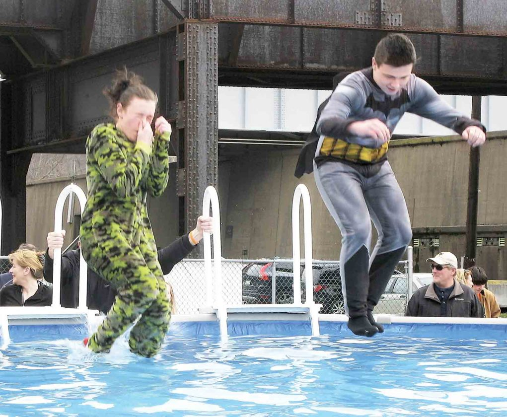 People fearless frigid water for Special Olympics