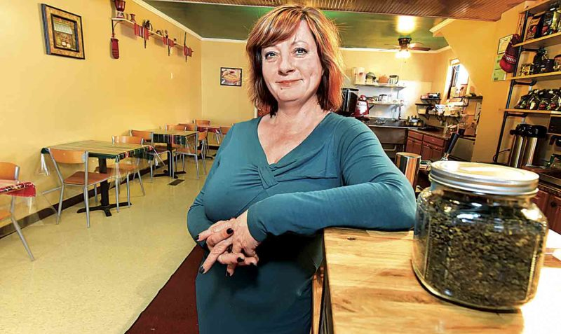 Photo by Jeff Baughan Petia Johnson is the owner of Unity Cafe at 212 Seventh St. in Parkersburg. The Bulgarian/American coffee house specializes in coffees and teas.