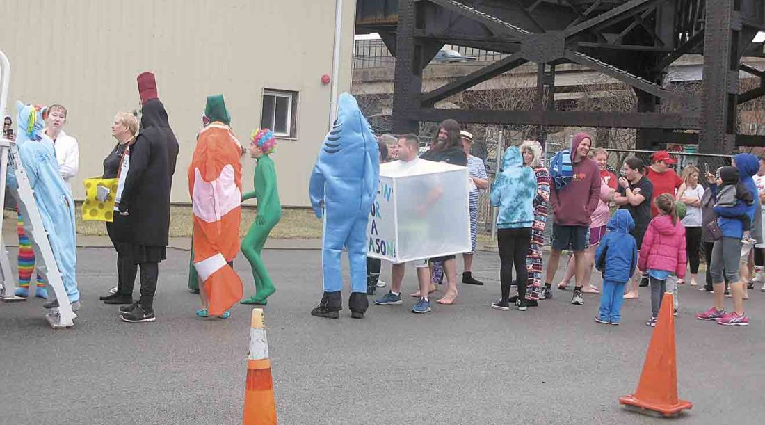 Those willing to take the plunge several in costumes lined up at the Point Park Marketplace on Saturday for the annual Polar Plunge 2018 — Freezin' for a Reason