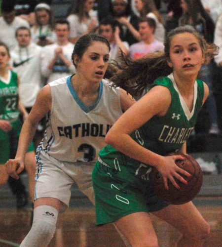 Parkersburg Catholic's Julia Ambrozy applies defensive pressure to Charleston Catholic guard Katie Nester during the Crusaderettes' 54-25 win Tuesday evening versus the Irish. Ambrozy, Olivia Ullman and Mikayla Alkire were honored on senior night. Photo by Jay W. Bennett