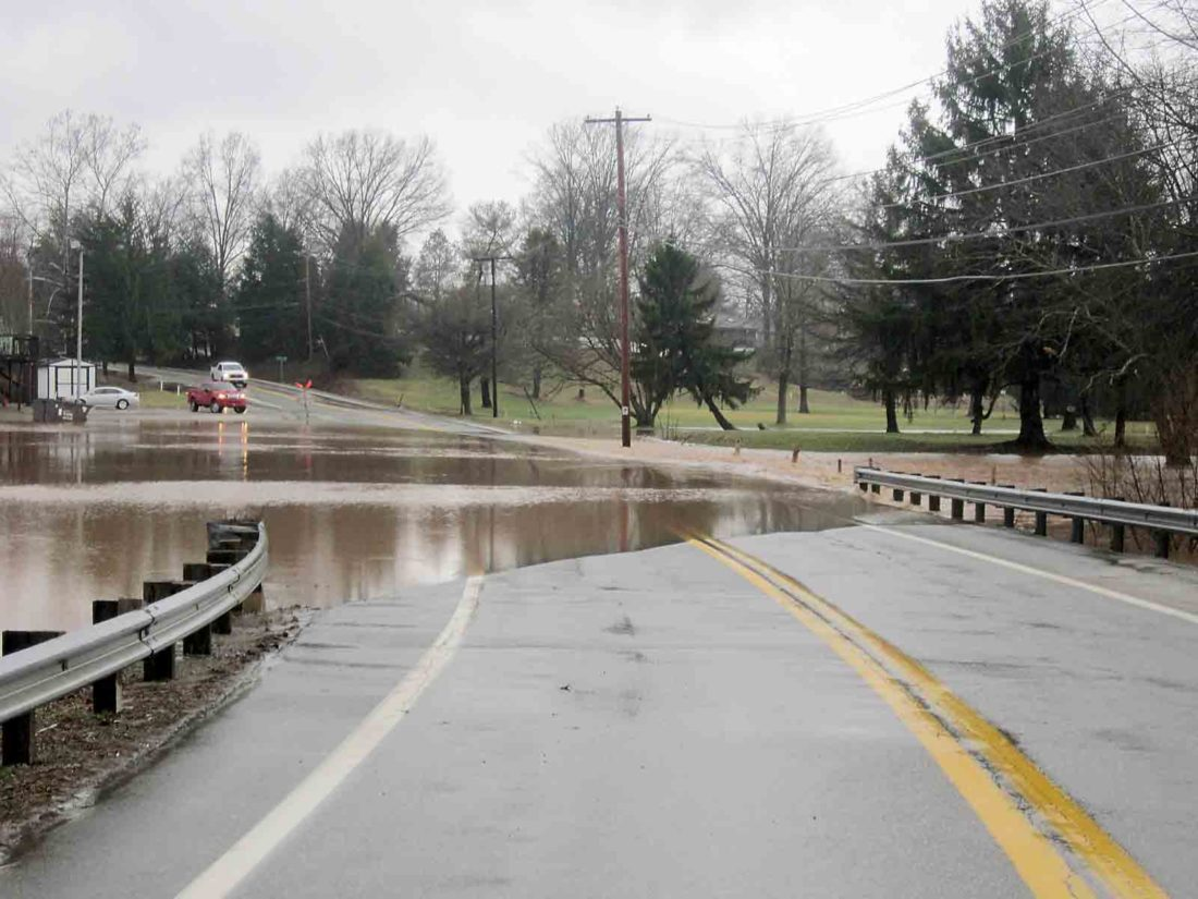 Photo by Wayne Towner Core Road off 36th Street in Parkersburg was closed Friday afternoon due to high water from Worthington Creek that crossed the roadway.