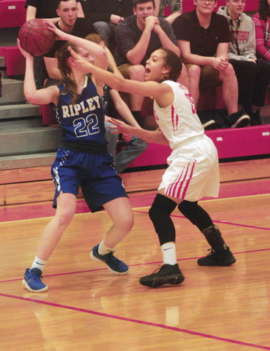 Parkersburg High's Tavien Clark plays aggressive defense on Ripley's Katelyn Sarver during the Big Reds' 66-30 Class AAA Region IV, Section 1 semifinal win over the Vikings Wednesday night.  Photo by Steve Hemmelgarn