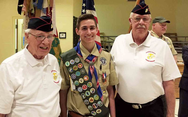 Photo Provided Bernie Lyons, left, and Roy Trembly of the Mid-Ohio Valley Platoon of the Marine Veterans Association stand with Eagle Scout Isaac Waters.