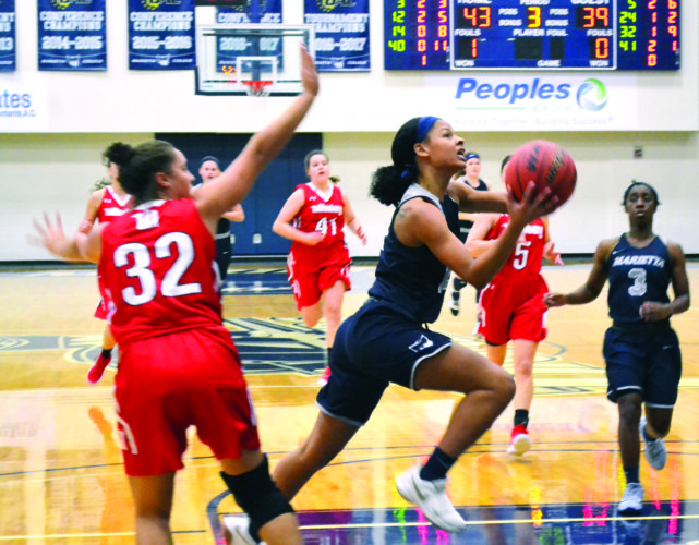 File photo Marietta College's Shay Lett, right, drives with the ball during a college women's basketball game earlier this season at Ban Johnson Arena. The Pioneers play Ohio Northern at 3 p.m. today in Ada for the Ohio Athletic Conference Tournament championship.