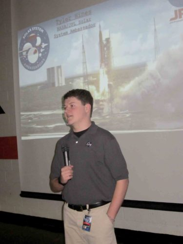 Photo by Wayne Towner Tyler Hines, a member of NASA's Solar System Ambassadors program, talks with Belpre High School students on Friday about the space agency's Orion spacecraft program.