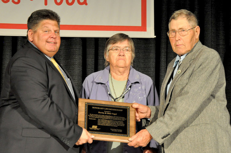 Submitted photo  Harley and Joan Vogel of rural New received the Honorary Life Membership Award in the Minnesota Farm Bureau from Farm Bureau President Kevin Paap (left) at the recent Minnesota Farm Bureau Federation annual meeting in Bloomington.