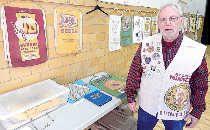 Ron Kelsey displays some of his favorite seed sacks.