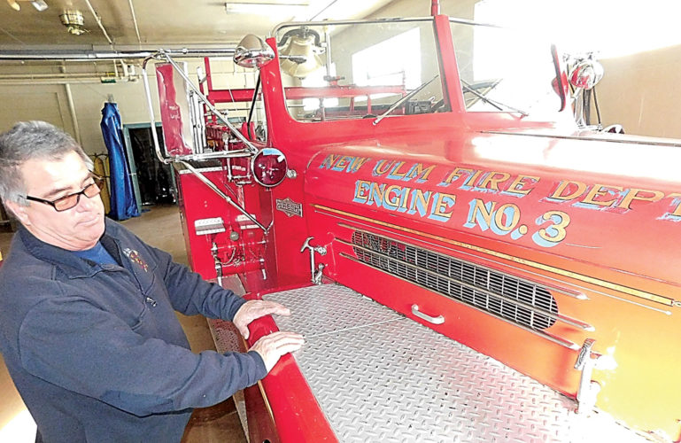New Ulm Fire Chief Paul Macho stands next to the 1958 Pirsch fire truck the NUFD uses in parades.
