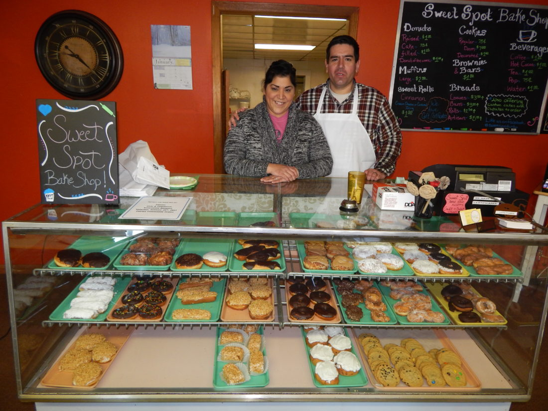 Staff photo by Fritz Busch  Fairfax Sweet Spot Bake Shop owner Tina Castillo, left, and her husband Robert Meyer stand behind the counter of the new business that opened last month downtown. Business hours are 6 a.m. to 3 p.m. Tuesday through Friday and 7 a.m. to 2 p.m. on Saturday.