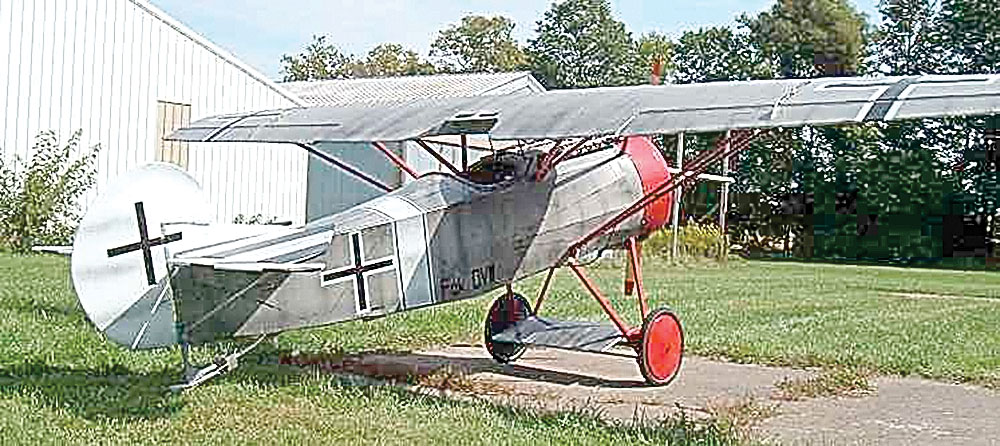 Alan Koenig collects World War I replica allied and central powers airplanes, like the one pictured here.