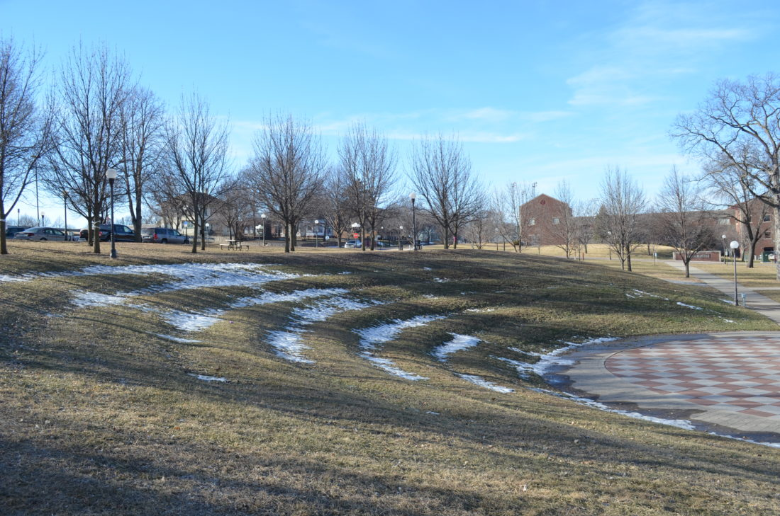 Staff photo by Connor Cummiskey  The earthen terraces at German Park have sloughed, leaving a noticeable ripple down the side of the hill. As is, the amphitheater seating is unusable for people with mobility issues or chairs.