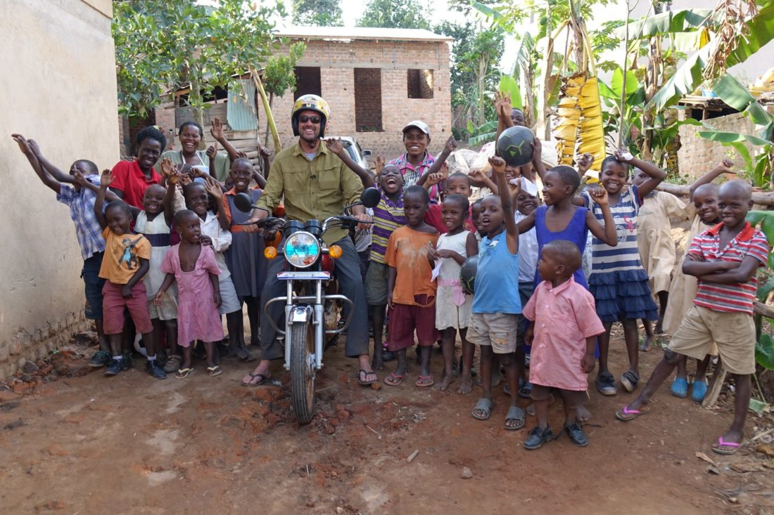 World Rider Foundation Founder, Mike Haley, with children at the Good Care Children's Ministry. (Taken from WRF website)