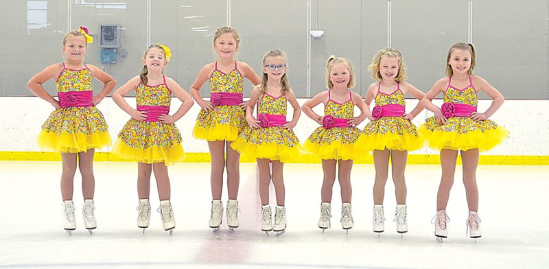 "The Alpha/Beta group will skate to Chubby Checker's ""Let's Twist Again"" in reference to the party game ""Twister."" Pictured from left to right: Amelia Holmberg, Natalia Frederickson, Kylie Berdan, Evalyn Altmann, Mollie Berdan, Ellie Hoffman and Chloe Beranek."