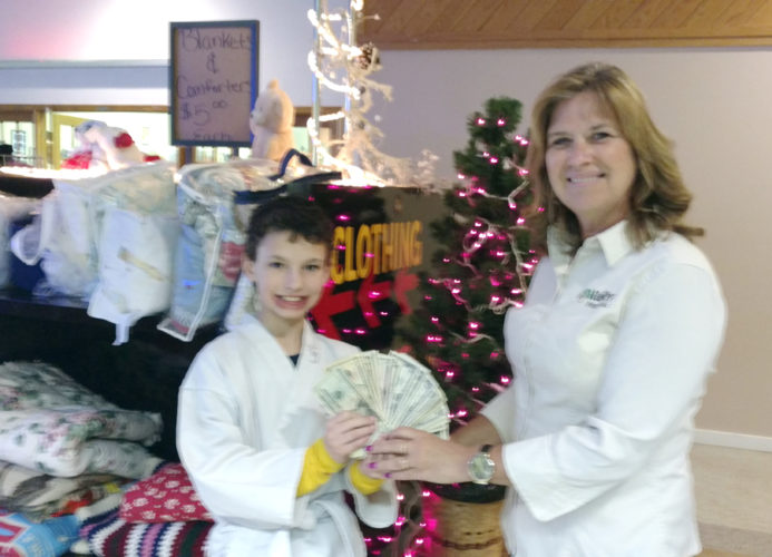 10-year-old Mason Janni wanted to save up and donate money to needy children in the area. He recently presented $133 to LaNaye Kral, chairperson for the Sertoma Club's Santa's Closet.
