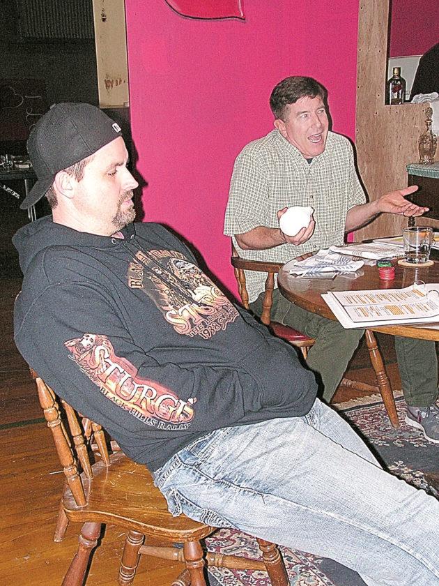 Below: Oscar and Felix talks at the table.