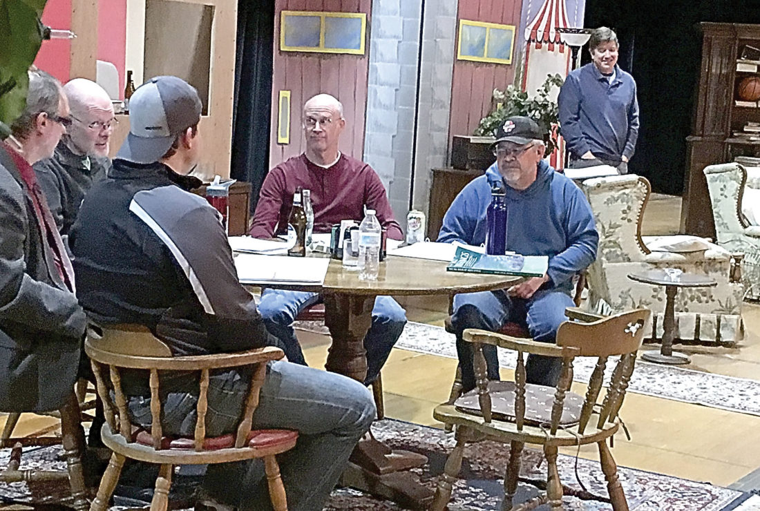 Right: The cast rehearses a scene from the play.