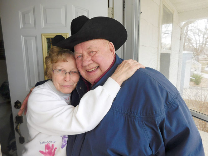 Elaine Domeier (left) hugs Dale Witt (right) who delivers her meal for the day. Domeier was previously a Meals on Wheels driver for several years after retiring and is now a recipient. Witt and his wife Mickey have volunteered as drivers for three years.