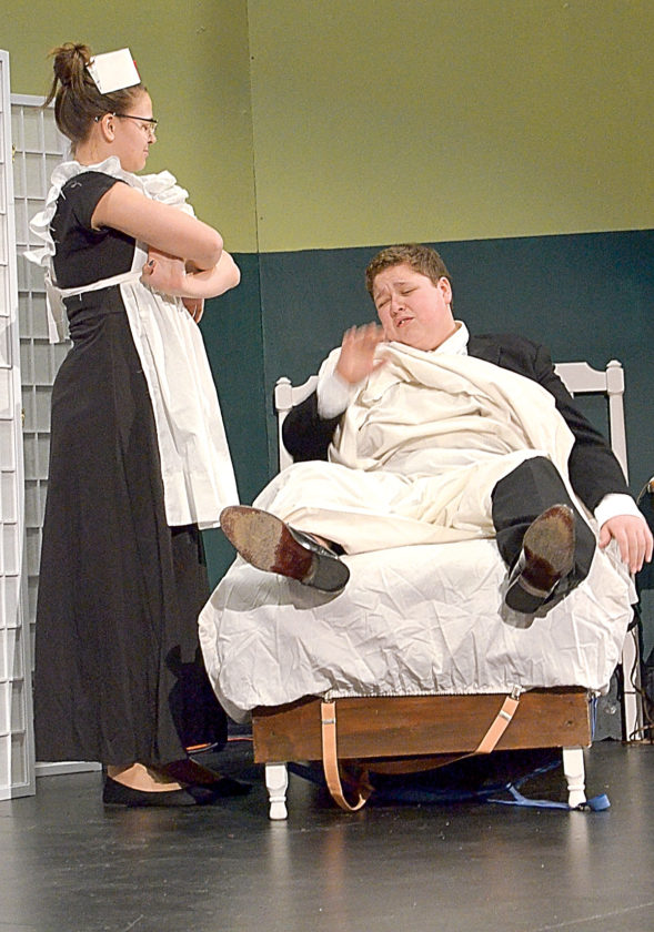 Nurse Hilda Hatchet (Abby Hietala), left, wakes Dr. Dogsbreath Devereaux (Braydon Hoffman) to inform him that Lotta Cash (Siiri Rakowski) is on her way to visit.