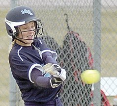 File photo by Steve Muscatello Minnesota Valley Lutheran's Hannah Biedenbender connects with a pitch during a recent game at MVL.